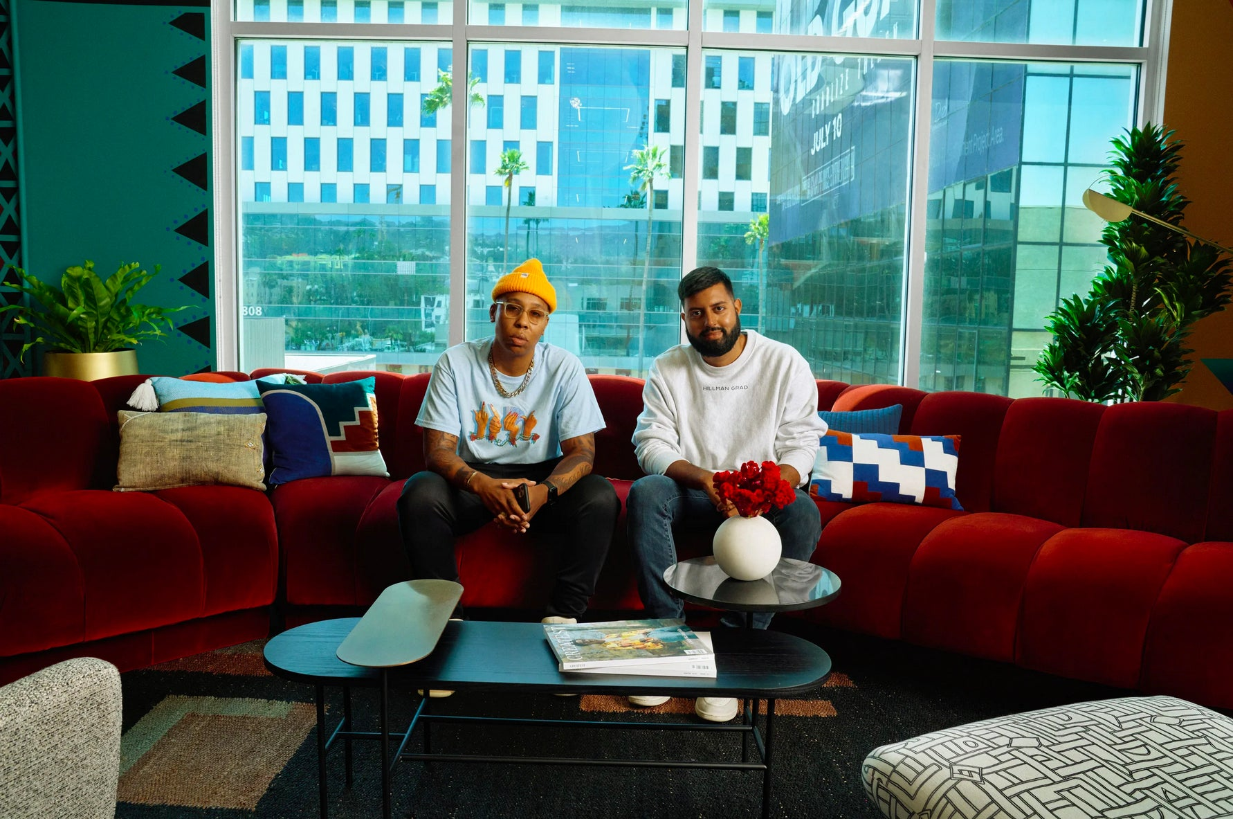 Producing partners Lena Waithe and Rishi Rajani sit on a vintage Steve Chase sofa in the reception area of Hillman Grad Productions. Interior design by Amie Mays. Cocktail table by &Tradition; Floor lamp by Bolia. Joshua Kissi