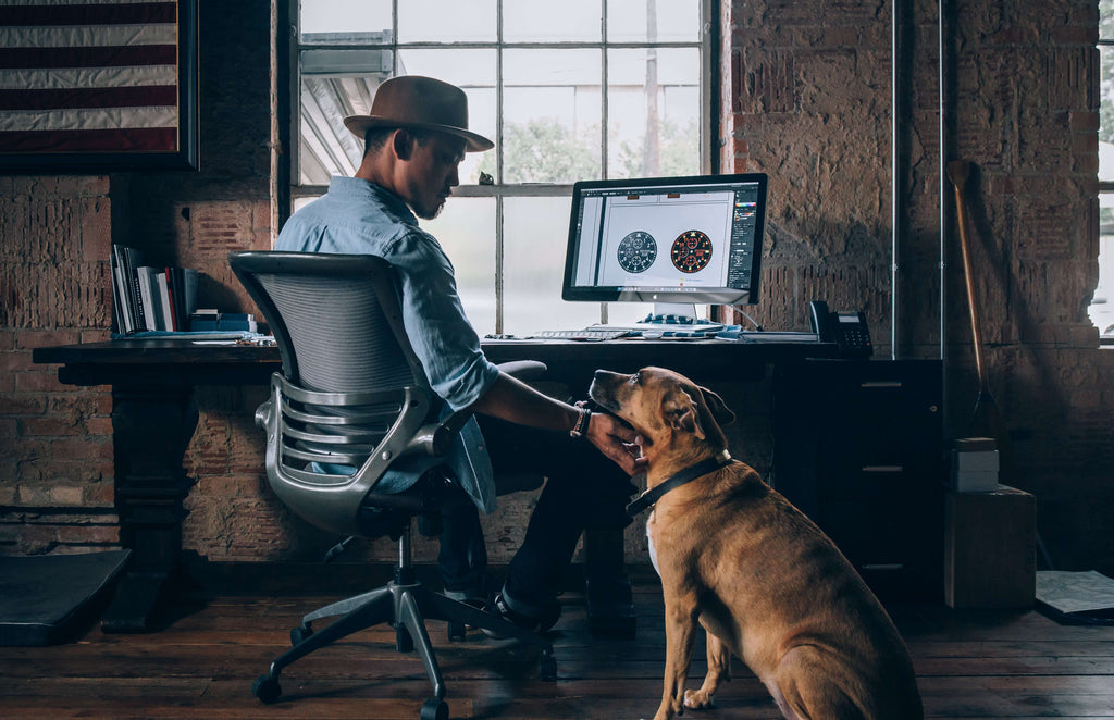 owner and dog working at home