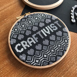 Craftivist cross stitch kit in support of Women's Aid