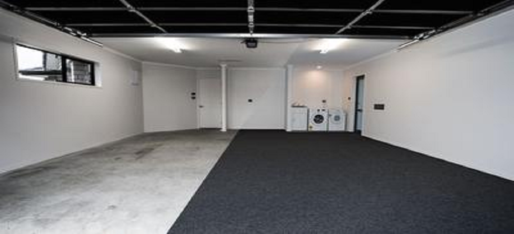 before and after photo of garage carpet