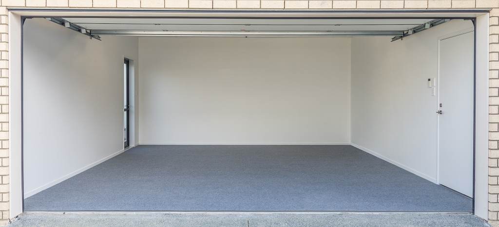 garage carpeted in light grey carpet