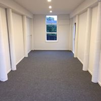 light grey garage carpet laid in a long single garage