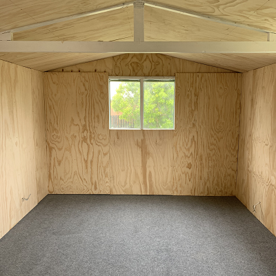 plywood walls with grey carpet