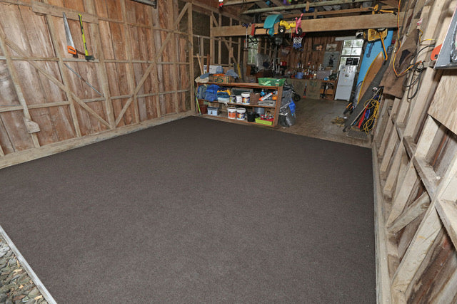 dark brown garage carpet in a old garage