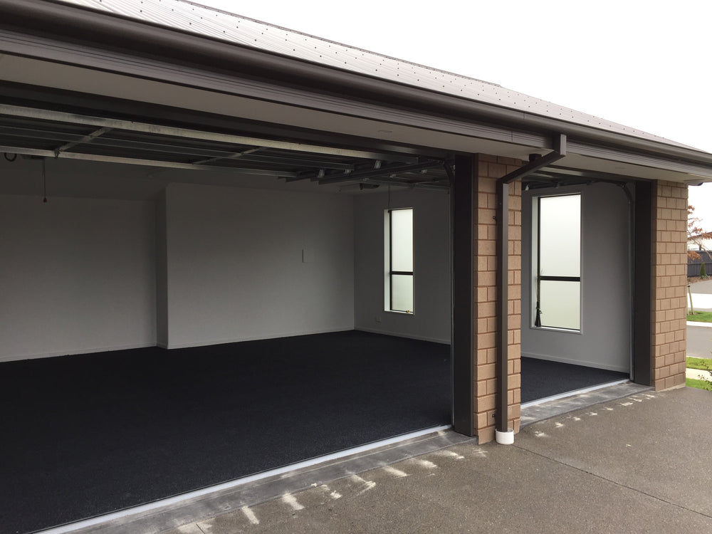 triple garage carpeted in charcoal