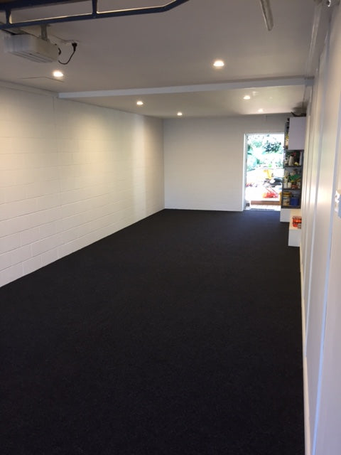 long garage with garage carpet on the floor