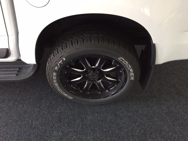 Ford Ranger wheel on charocal garage carpet
