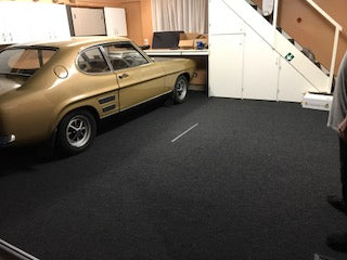 classic car on garage carpet
