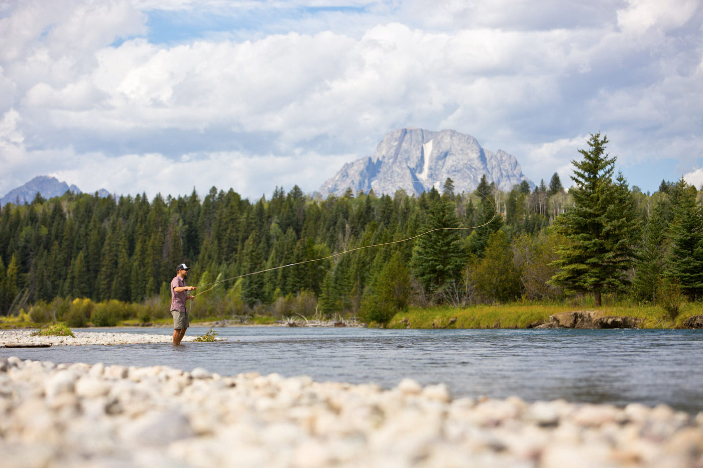 Man fly-fishing in front of Mount Moran in Grand Teton National Park. Jackson Hole, Wyoming. Photo: Tuck Fauntleroy