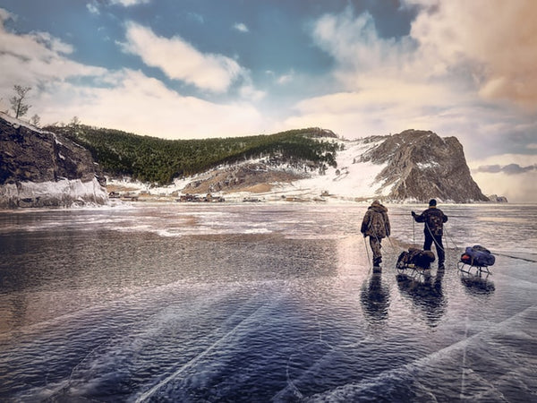 two-men-crossing-frozen-lake-jpg