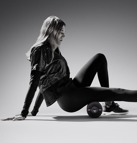 Woman Using Hyperice Vyper 2 Foam Roller