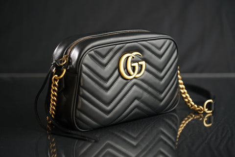 Black Gucci bag with gold strap