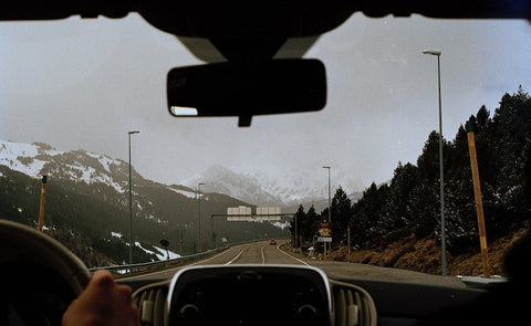 drivers-perspectives-view-of-road-and-mountains-covered-in-snow-jpeg