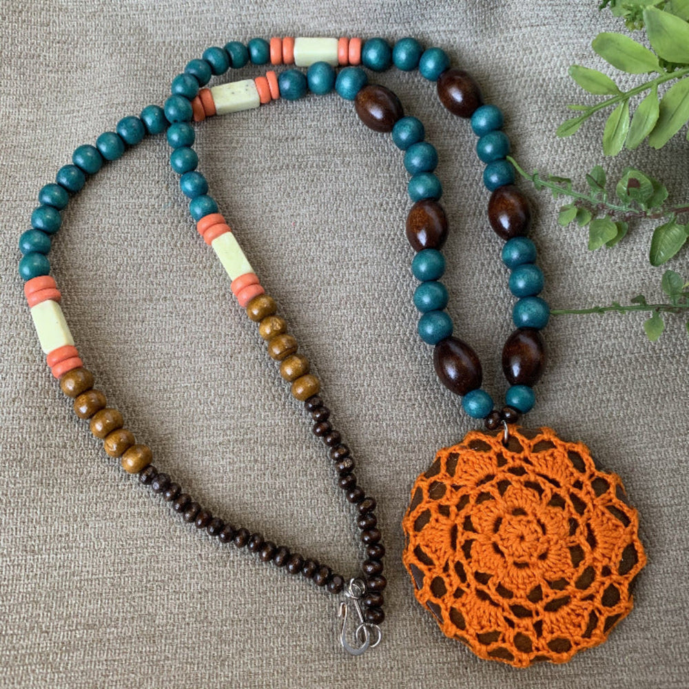Load image into Gallery viewer, Long Wooden Bead Necklace with Crochet Pendant in Bright Orange