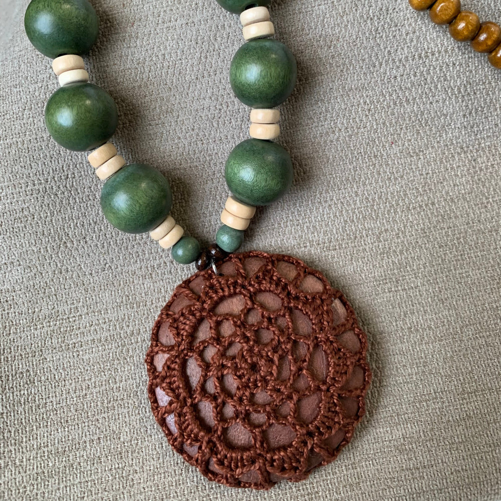 Load image into Gallery viewer, Long Wooden Bead Necklace with Crochet Pendant in Brown and Deep Green