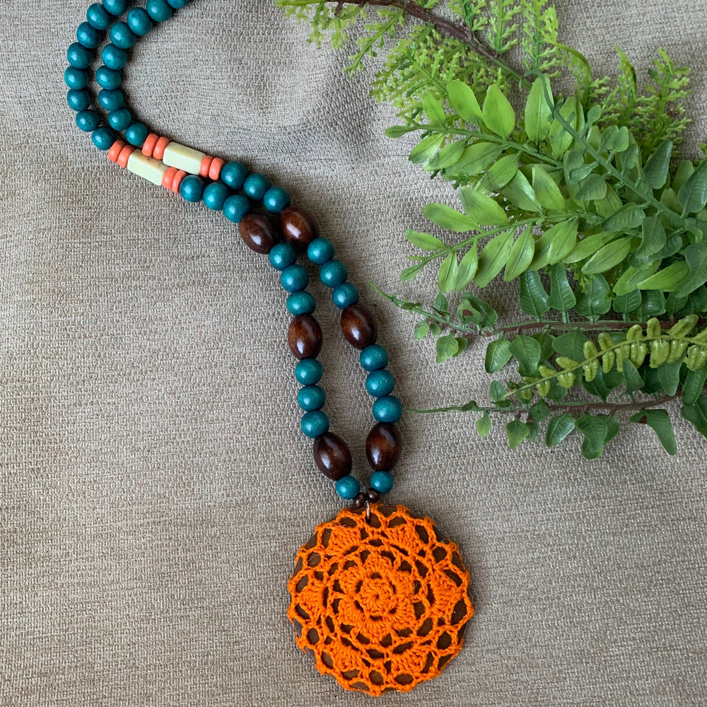 Long Wooden Bead Necklace with Crochet Pendant in Bright Orange