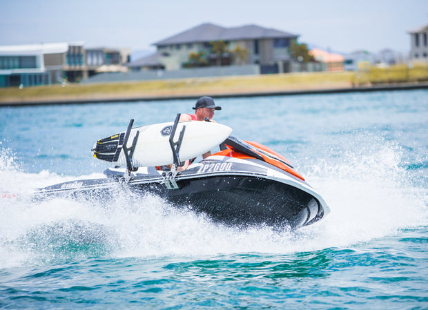 Jet ski in action with board rack secured