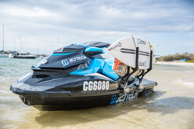 Jet ski with board rack system, holding 2 boards