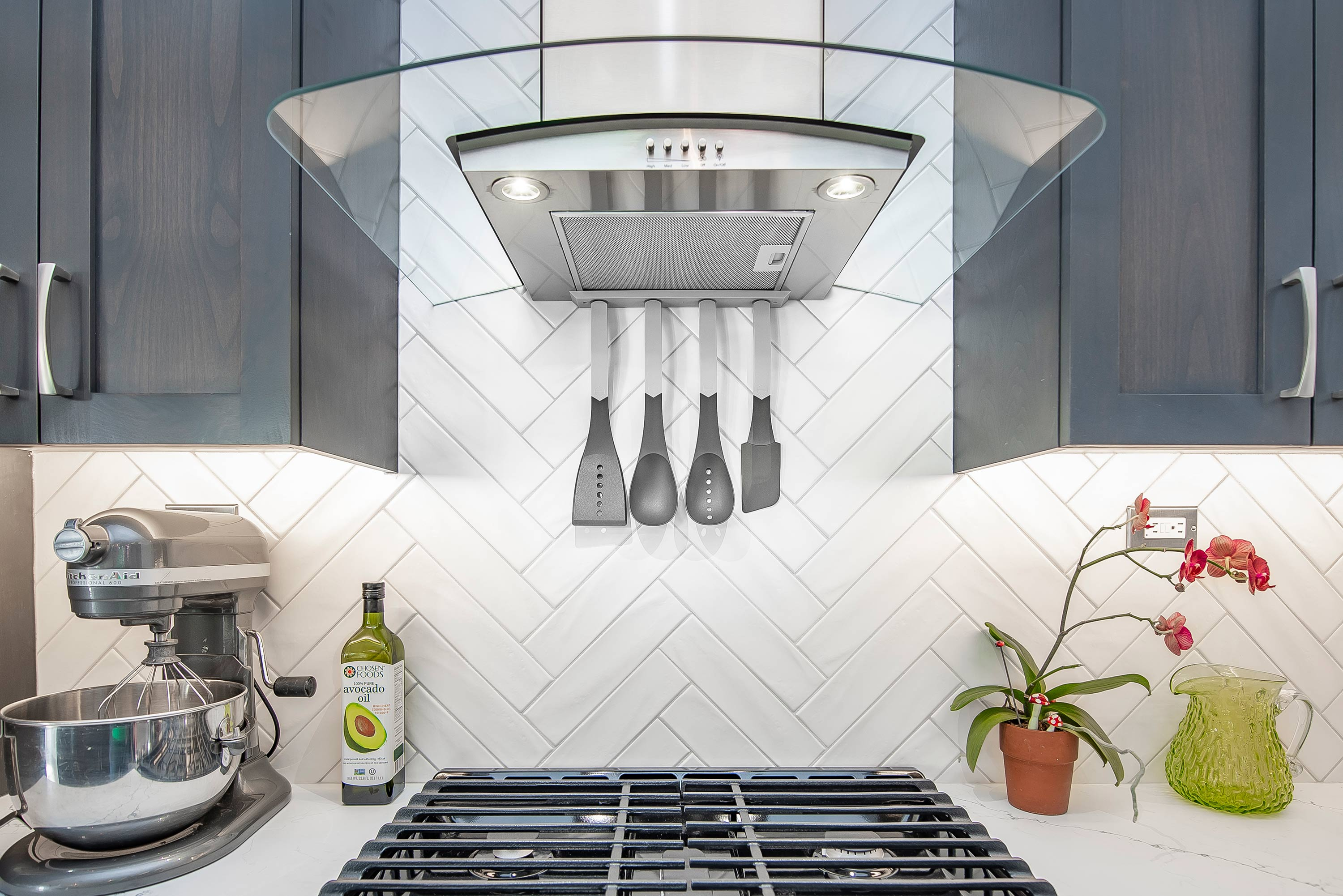 Magnetic Utensil Rack attached to vent hood by powerful magnets