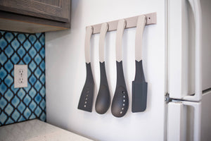 The Magnetic Utensil Rack sticks to vertical surfaces like a fridge