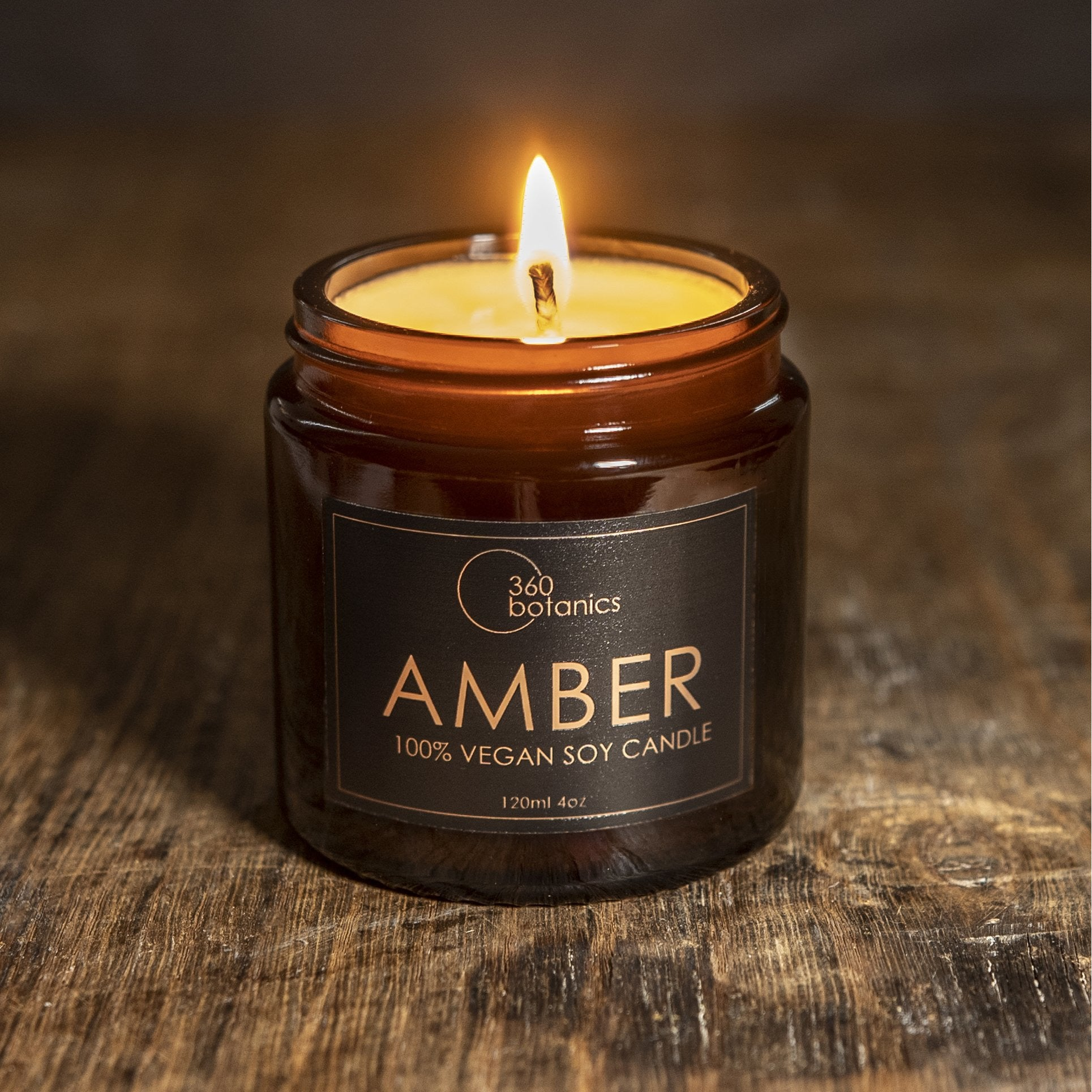 Image of Amber Candle photographed it on rustic wooden surface