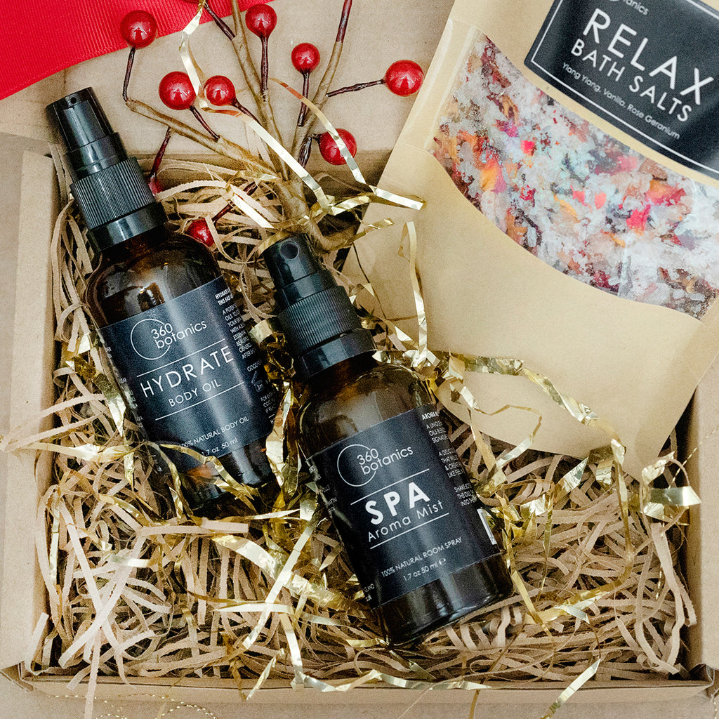 Image of hydrate body oil and spa aroma mist photographed in gift box with relax bath salts