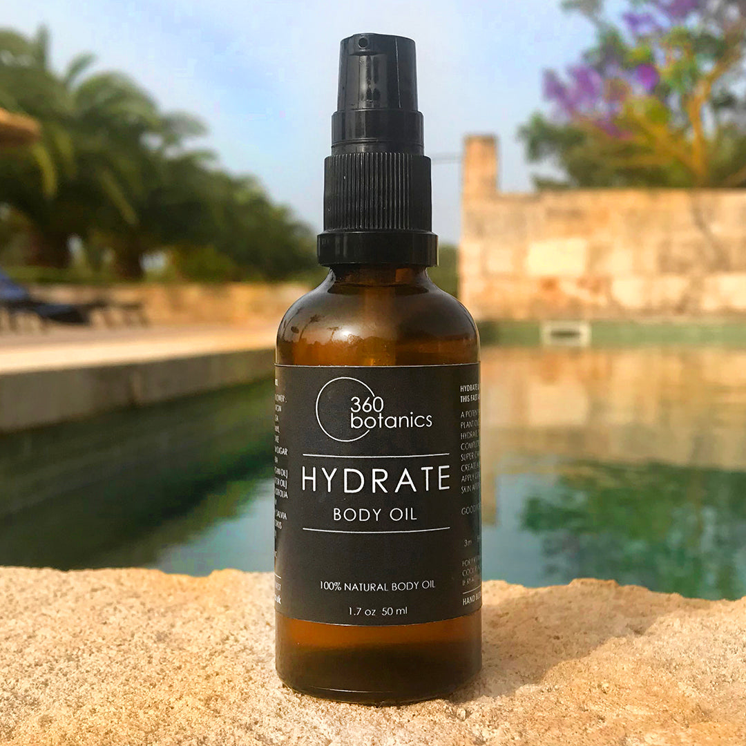 image of hydrate body oil photographed by a swimming pool in spain