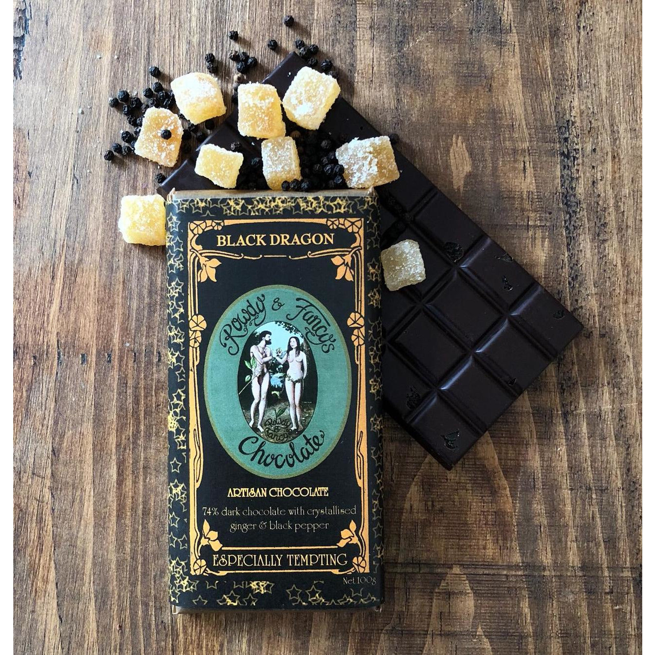 Image of Black-Dragon chocolate bar by chocolatier Rowdy_Fancy photographed on wooden surface with ginger pieces