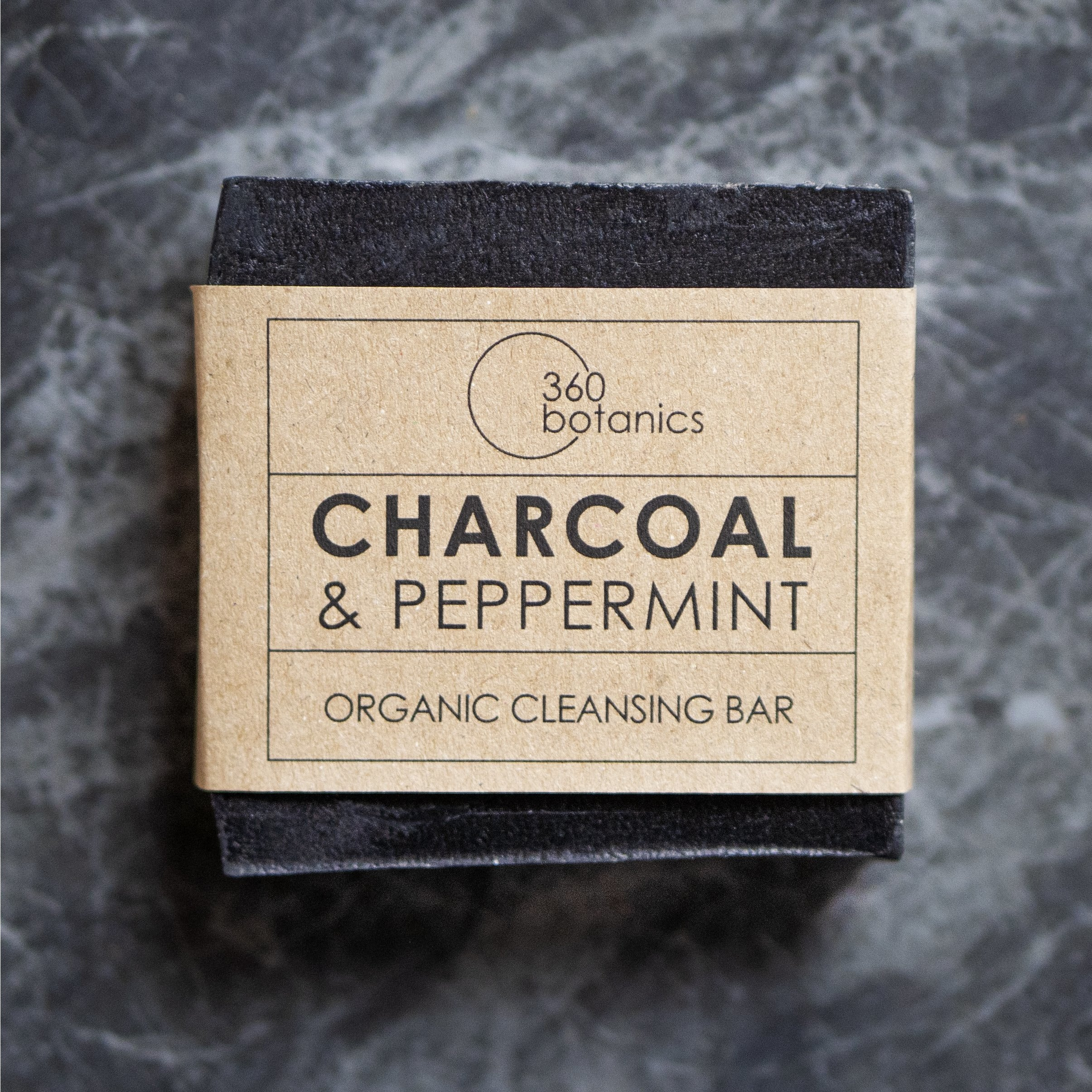 image of 360 botanics charcoal and Peppermint soap on dark background