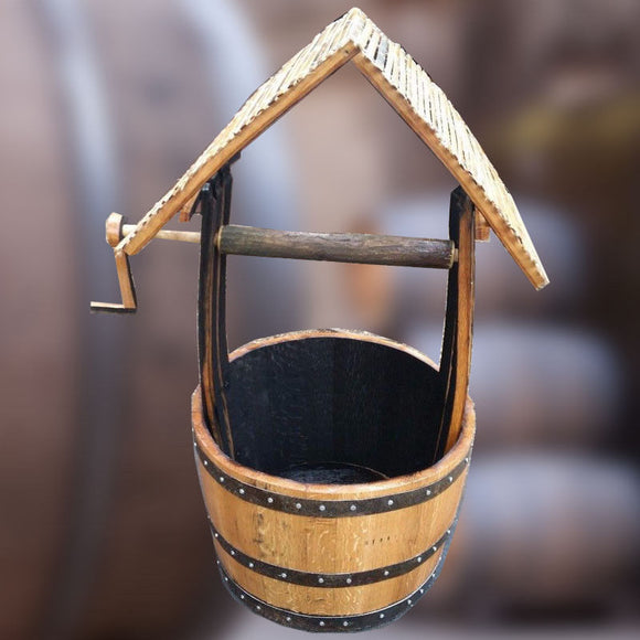 whisky barrel wishing well planter