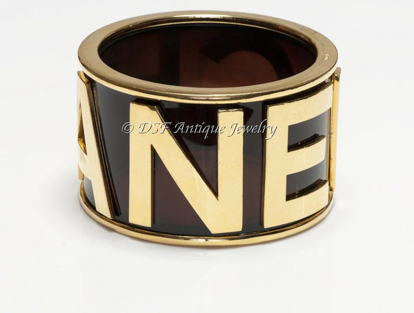 CHANEL Paris 1990's Brown Lucite Letter Logo Charm Bangle Bracelet
