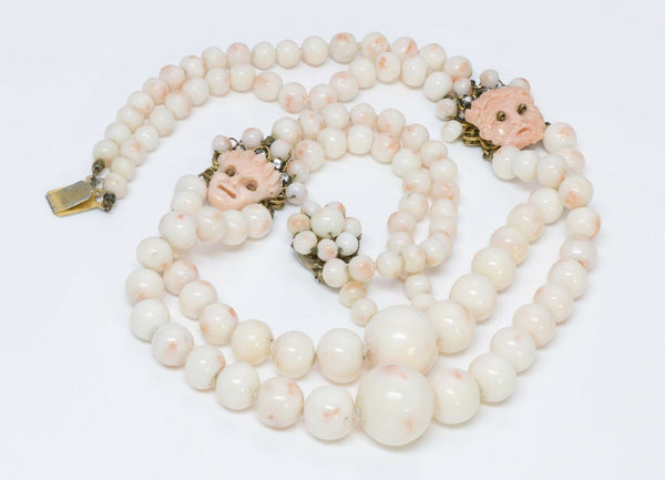 Louis Rousselet Faux Coral Beads Masks Strand Necklace