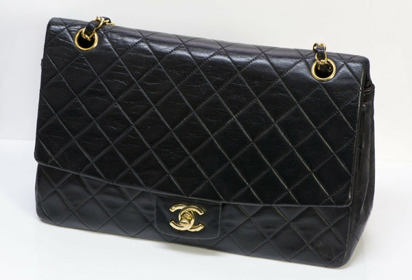 CHANEL CC Black Quilted Leather Medium Flap Bag
