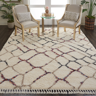 A high-pile length rug, being placed in an elegant living room setting.