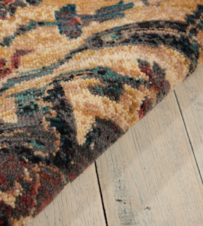A close-up on a medium pile rug, demonstrating the length of each yarn in the rug.