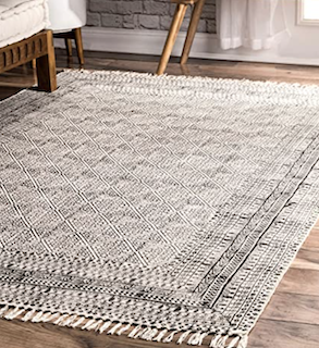 A fully-woven flat-weave rug demonstrates the flexible, wear and tear nature of these rug woven types.