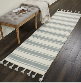 A flat-weave rug is placed in a hallway, demonstrating that low-pile rugs sit in high traffic areas.