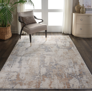 A contemporary-style 5x8 rug is displayed near a window, with a chair sitting on top.