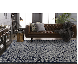 A 8x11 navy-blue, periodic style transitional rug is displayed in a living room setting.