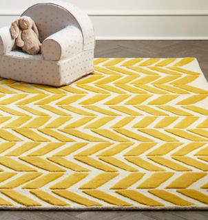 5x8 yellow and beige modern style rug displayed in a room setting.