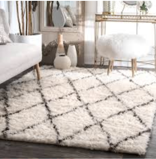 8x11 White and Black Moroccan style shag rug displayed in living room.
