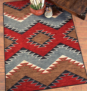 A 4x6 red, blue beige and brown Southwest style rug displayed on the floor.