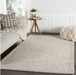 An 5x8 muted Scandinavian style rug, displayed in a living room.