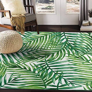 A 5x8 tropical style rug, decorated with leafs.