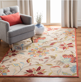 A 5x8 floral style rug placed on top of a chair.