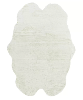 A white colored novelty style rug, with a unique shape.