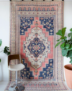A Turkish rug created with Turkish knots, demonstrating the symmetry present in design.