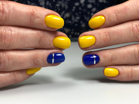 Yellow and blue Haruyama gel polish with silver foil lines