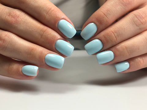 Beautiful Russian dry machine E-file manicure with light blue gel polish