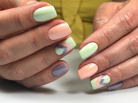 Beautiful light green, pink and purple gel nail polishes